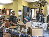 BLF Canada director Toe Blake Roy, BLF Canada missionaries Francois and Marie-Paule Bedard packing boxes for Haiti with volunteers from the church in Lachute
